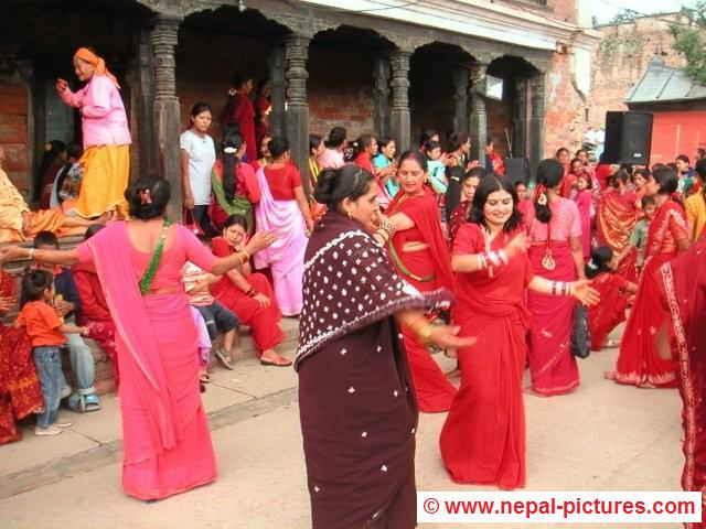 Women dancing during Teej