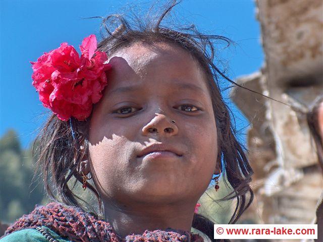 Girl with Rodondendren flower in Murma village